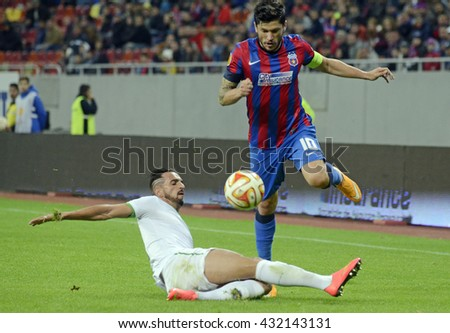 BUCHAREST, ROMANIA - OCTOBER 23, 2014: Cristian Tanase pictured during the UEFA Europa League game between Steaua Bucuresti and Rio Ave on National Arena. - stock photo