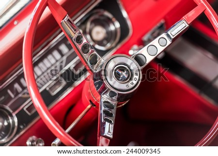 BUCHAREST, ROMANIA - OCTOBER 31, 2014: 1967 Ford Mustang Car Interior. The Ford Mustang is an automobile manufactured by the Ford Motor Company and was introduced on April 17, 1964. - stock photo
