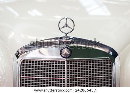 BUCHAREST, ROMANIA - OCTOBER 31, 2014: Mercedes Benz 220S Sign Close Up. Founded in 1926 is a German luxury automobile manufacturer, a multinational division of the German manufacturer Daimler AG. - stock photo