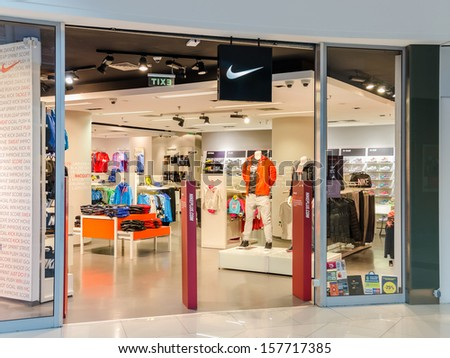 BUCHAREST, ROMANIA - OCTOBER 09: Nike store on October 09, 2013 in Bucharest, Romania. It is one of the world's largest suppliers of athletic shoes and a major manufacturer of sports equipment. - stock photo