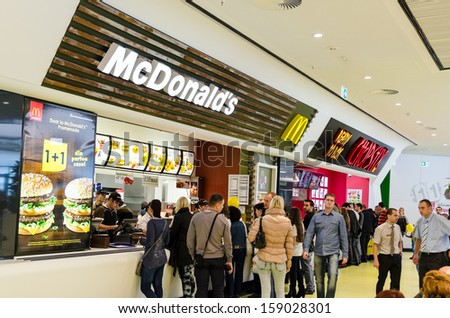 BUCHAREST, ROMANIA - OCTOBER 18: People buying fast-food from McDonald's Restaurant on October 18, 2013 in Bucharest, Romania. McDonald's is the main fast-food restaurant chain in Romania. - stock photo