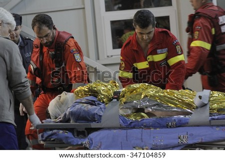 Bucharest, Romania, October 31, 2015: Romanian paramedics transfer a wounded person, who survived from a fire at a Colectiv Club from the Emergency Hospital Floreasca to a burn center.  - stock photo