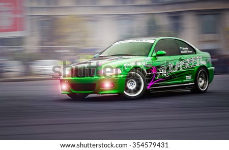 BUCHAREST, ROMANIA - OCTOBER 23: Unidentified driver participates in a drifting demonstration at Drift Garnd Prix of Romania Contest in Bucharest on October 23, 2011 Bucharest, Romania - stock photo