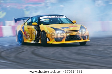BUCHAREST, ROMANIA - OCTOBER 23: Unknown driver performs during a drifting demonstration at Drift Garnd Prix of Romania Contest in Bucharest., October 23, 2011, Bucharest, Romania - stock photo
