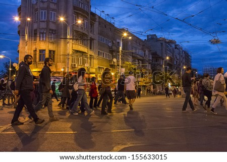 BUCHAREST, ROMANIA - SEPT 22: People join the protests for the 22nd day against the plan to open Europe's largest open-cast goldmine in the Rosia Montana on Sept 22, 2013 in Bucharest, Romania. - stock photo