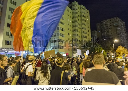 BUCHAREST, ROMANIA - SEPT 22: Unidentified people protest for the 22nd day against the plan to open Europe's largest open-cast goldmine in the Rosia Montana on Sept 22, 2013 in Bucharest, Romania. - stock photo