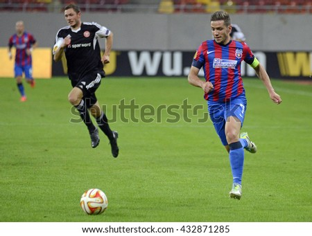 BUCHAREST, ROMANIA - SEPTEMBER 18, 2014: Alexandru Chipciu pictured during the UEFA Europa League game between Steaua Bucuresti and Aalborg on National Arena. - stock photo