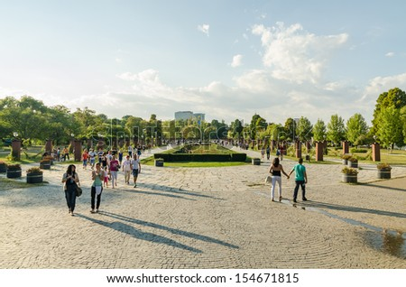 BUCHAREST, ROMANIA - SEPTEMBER 08: Herastrau Park on September 08, 2013 in Bucharest, Romania. Located north in Bucharest the park was finished in May 1939 becoming Bucharest largest public park. - stock photo