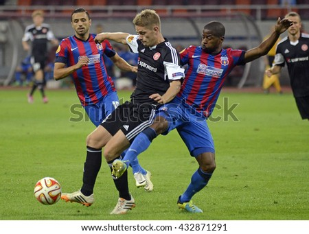 BUCHAREST, ROMANIA - SEPTEMBER 18, 2014: Lucian Sanmartean, Mathias Wichmann and Nicandro Breeveld pictured during the UEFA Europa League game between Steaua Bucuresti and Aalborg on National Arena. - stock photo