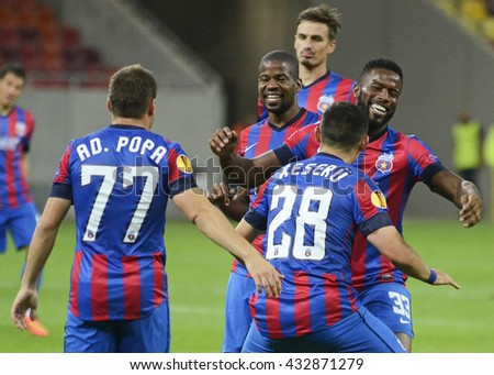 BUCHAREST, ROMANIA - SEPTEMBER 18, 2014: Steaua players celebrate a goal scored during the UEFA Europa League game between Steaua Bucuresti and Aalborg on National Arena. - stock photo