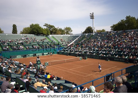 BUCHAREST,ROMANIA - SEPTEMBER 20: Tennis players VICTOR HANESCU versus SOMDEV DEVVARMAN performs at DAVIS CUP at BNR Arena September 20, 2008 in Bucharest,Romania - stock photo