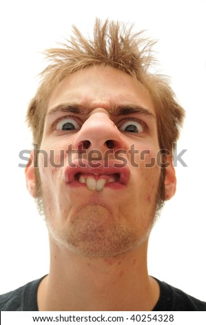 Buck toothed man making a very odd face. - stock photo