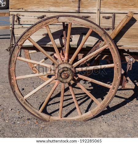 Buckboard is a four-wheeled wagon of simple construction meant to be drawn by a horse or other large animal. - stock photo
