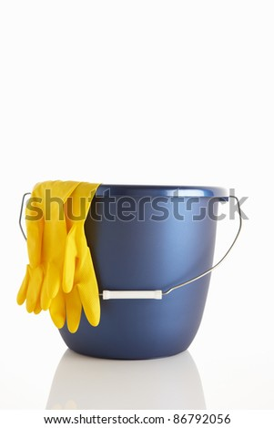 Bucket and rubber gloves