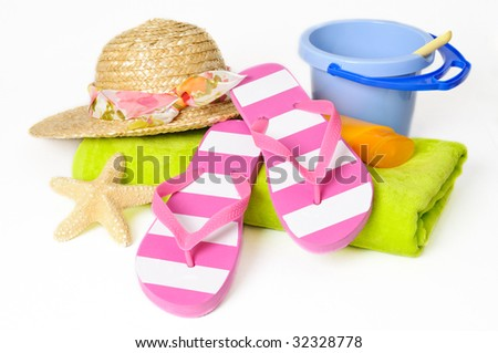 Bucket and spade with flip flops and other beach items