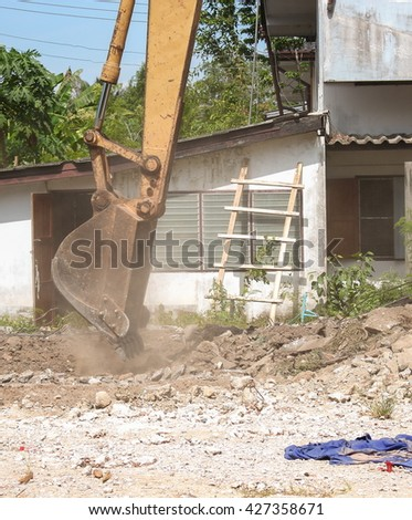 bucket Excavator. excavator destruction in Work outdoor  construction,and  dust soil motion : select focus front bucket Excavator : - stock photo