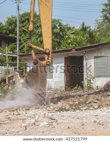 bucket Excavator. excavator destruction in Work outdoor  construction  that dust motion : select focus front bucket Excavator : - stock photo