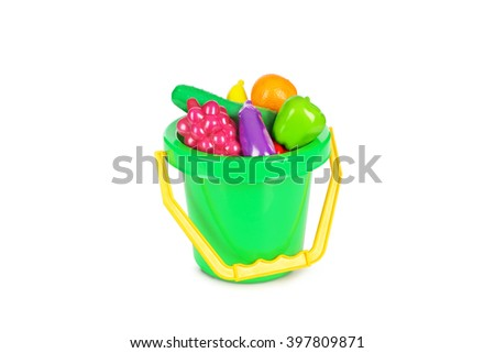 Bucket full of plastic fruity isolated on white background. - stock photo