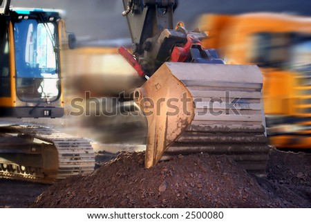 Bucket of backhoe on construction project - stock photo