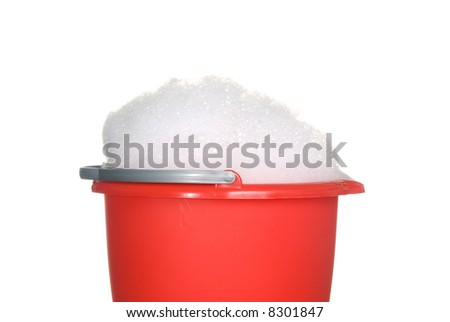 Bucket of foamy cleaning detergent waiting to be used - stock photo