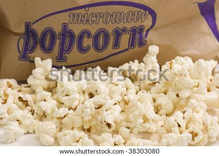 Bucket of popcorn on white background. - stock photo