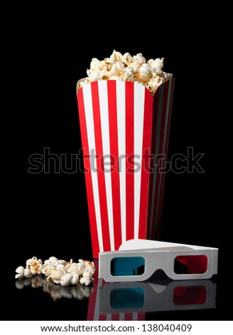 Bucket of popcorn with 3D glasses - stock photo