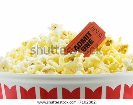 Bucket of popcorn with movie ticket - stock photo