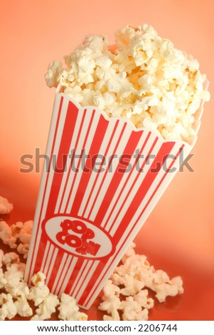bucket of warm  and delicious microwave popcorn - stock photo