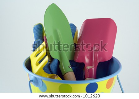 Bucket, spade, trowel, rake and gloves