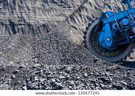 bucket wheel excavator and coal - stock photo