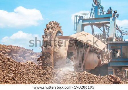 Bucket wheel excavator closeup in the open pit mine - stock photo