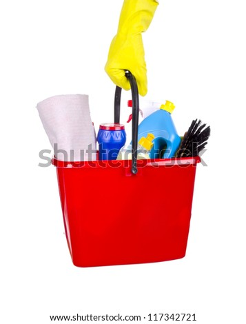 Bucket with cleaning items in hand isolated on white - stock photo