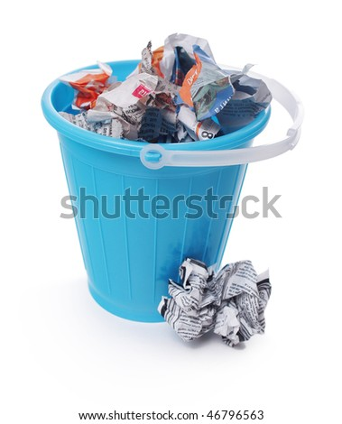 Bucket with paper garbage