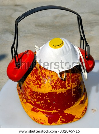 bucket with tools and construction safety equipment. Helmet, cap, mask, etc. - stock photo