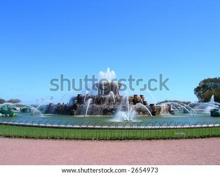 Buckingham Fountain in Chicago Millennium Park against clear blue sky - stock photo