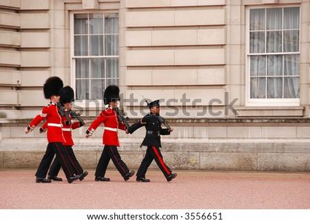 Buckingham Palace guards marching - stock photo