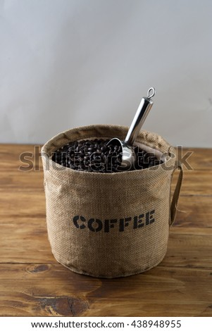 Buckle of coffee beans roasted isolated on wooden and grey background