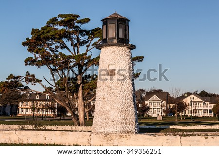 Buckroe Beach lighthouse in Hampton, Virginia with houses in background. - stock photo