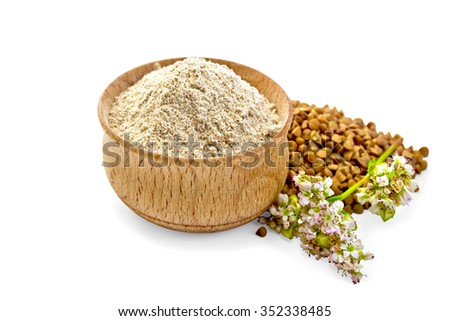 Buckwheat flour in a wooden bowl, buckwheat, buckwheat flower isolated on white background - stock photo