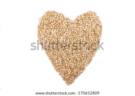 buckwheat groats in shape heart Isolated on white background