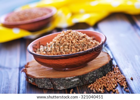 buckwheat groats on wooden background. healthy organic food