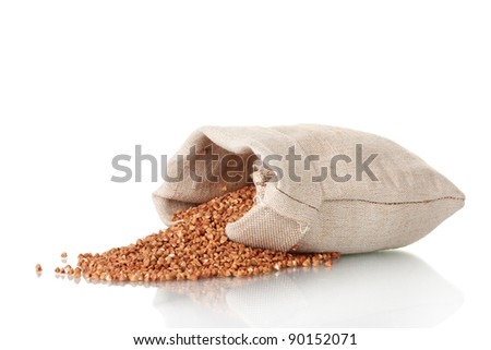 Buckwheat in a bag isolated on white - stock photo