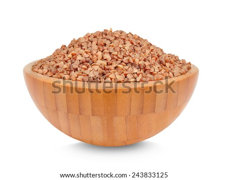 buckwheat in a wooden bowl isolated on white - stock photo