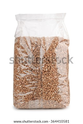 Buckwheat in plastic packet isolated on white - stock photo