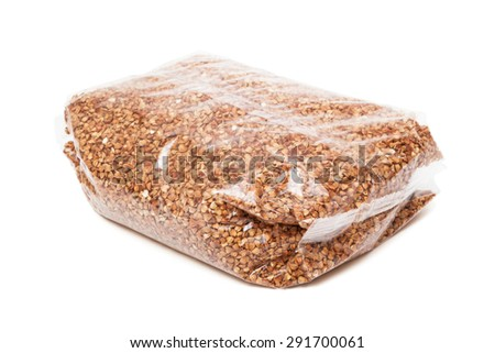 buckwheat in the package on white background - stock photo