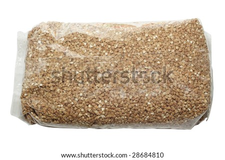buckwheat in the plastic packet under the white background - stock photo