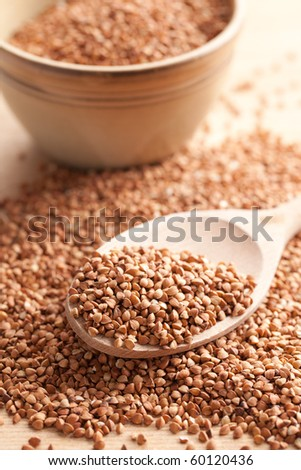 buckwheat in wooden spoon - stock photo