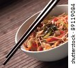 Buckwheat noodles with chicken and vegetables in Japanese style - stock photo
