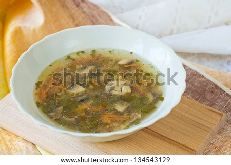buckwheat soup with mushrooms on white plate