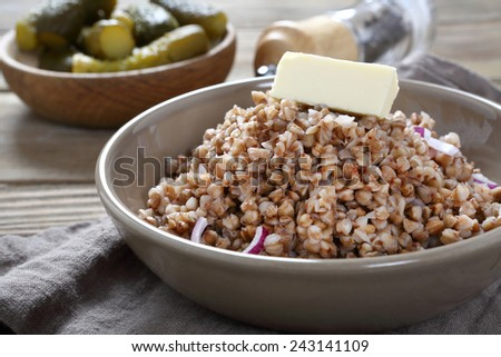 Buckwheat with butter in a bowl, food - stock photo